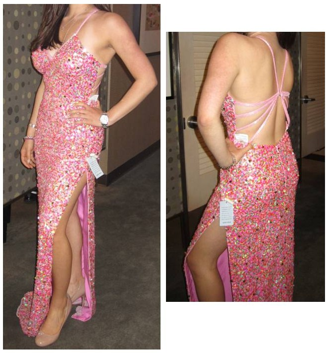 The low v-neck on this gown shows a lot of cleavage and the high leg slit is rather revealing. The low back with cut-outs also shows too much skin. While the sparkles and pink are fun, it's too much for a formal setting.